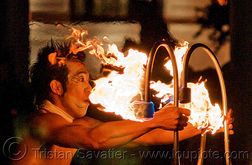 dai zaobab holding S-shaped fire staves - japanese fire performer, dai zaobab, fire dancer, fire dancing expo, fire performer, fire spinning, fire staffs, fire staves, flames, man, night, spinning fire, temple of poi