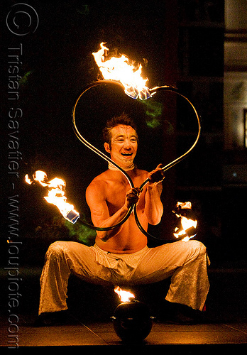dai zaobab with S-shaped fire staves - japanese fire performer - temple of poi 2009 fire dancing expo - union square (san francisco), dai zaobab, fire dancer, fire dancing expo, fire performer, fire spinning, fire staffs, fire staves, flames, man, night, spinning fire, temple of poi
