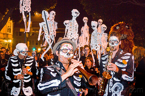 dancing skeletons - paper puppets, crowd, dancing skeletons, day of the dead, dia de los muertos, halloween, night, paper skeleton puppets, paper skeletons, procession, street musicians