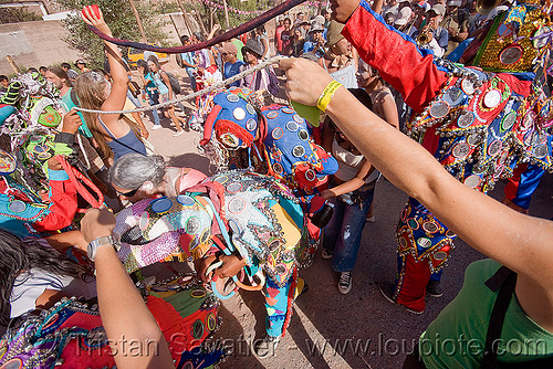 dancing under the tails of the diablos - carnaval de tilcara (argentina), andean carnival, costume, diablo carnavalero, diablo de carnaval, folklore, horns, indigenous culture, man, mask, mirrors, noroeste argentino, quebrada de humahuaca, tilcara, tribal