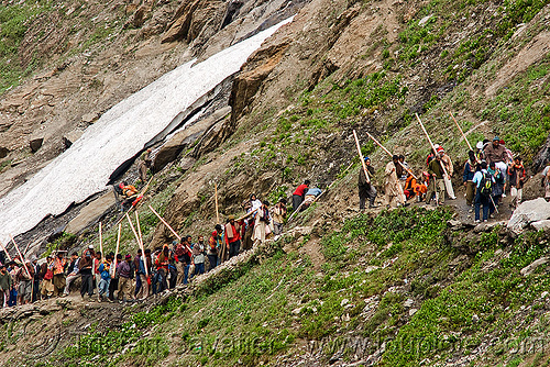 dandi / doli porters with their sticks on the trail - amarnath yatra (pilgrimage) - kashmir, amarnath yatra, bearers, dandi, doli, hiking, hindu pilgrimage, india, kashmir, mountain trail, mountains, pilgrims, porters, snow, sticks, trekking, wallahs