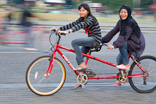 daughter and mother riding tandem, child, family, girl, jakarta, java, kid, man, medan merdeka, merdeka square, moving, park, riding, road, tandem bicycle, tandem bike, woman