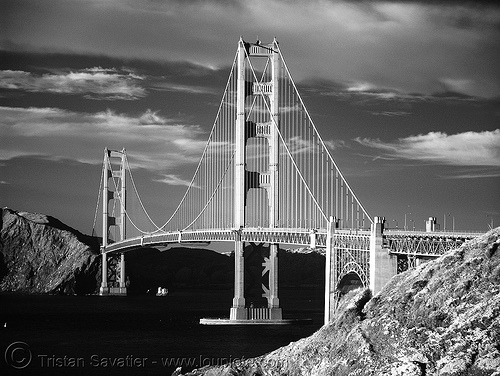 daylight infrared photo of the golden gate bridge (san francisco), black water, bridge pillars, bridge towers, daylight infrared, golden gate bridge, near infrared, suspension bridge