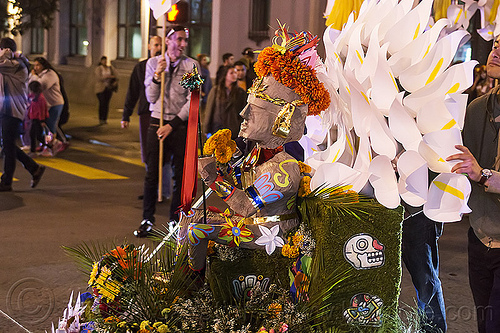 decorated aztec statue - dia de los muertos procession (san francisco), aztec sculpture, calla lilies, day of the dead, decorated, dia de los muertos, flower crown, halloween, night, orange flowers, orange marigold, statue