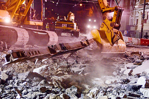 demolition of municipal railway tracks, at work, bucket attachment, caterpillar, demolition, excavator bucket, heavy equipment, light rail, machinery, muni, night, ntk, railroad construction, railroad tracks, rails, railway tracks, san francisco municipal railway, track maintenance, track work, working