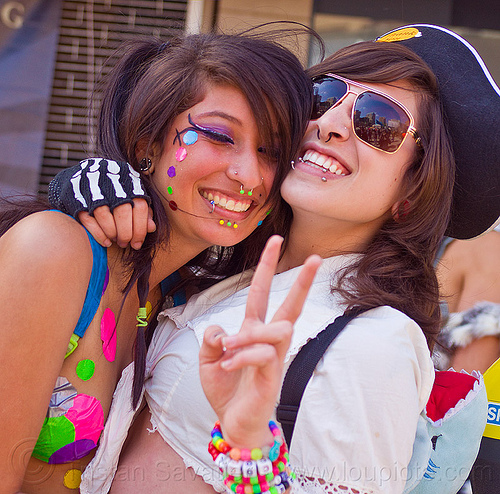 devin and jessica, color pasties, color polka dots, how weird festival, kandi bracelet, lip piercing, peace sign, pirate costume, rainbow pasties, rainbow polka dots, v sign, women