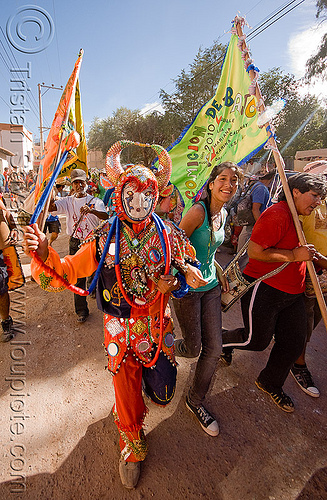 diablo carnavalero and flags bearers - carnaval  - tilcara (argentina), andean carnival, costume, diablo carnavalero, diablo de carnaval, folklore, horns, indigenous culture, man, mask, mirrors, noroeste argentino, quebrada de humahuaca, tilcara, tribal