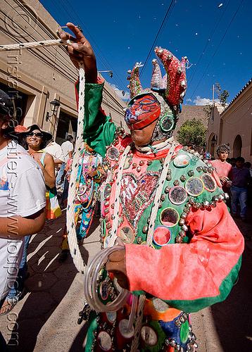 diablo carnavalero holding his tail - carnaval (argentina), andean carnival, careta de diablo, costume, diablo carnavalero, diablo de carnaval, folklore, horns, indigenous culture, man, mask, mirrors, noroeste argentino, quebrada de humahuaca, tilcara, tribal