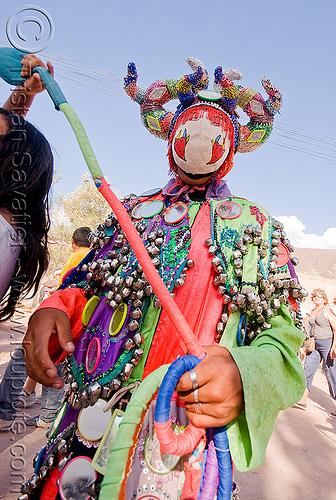 diablo de carnaval dancing with woman holding tail - tilcara (argentina), andean carnival, careta de diablo, costume, dancing, diablo carnavalero, diablo de carnaval, folklore, horns, indigenous culture, man, mask, mirrors, noroeste argentino, quebrada de humahuaca, quechua culture, tail, tilcara, tribal