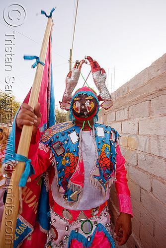 diablo near wall - carnaval de humahuaca (argentina), andean carnival, comparsa, costume, diablo carnavalero, diablo de carnaval, flag, folklore, horns, indigenous culture, los picaflores, man, mask, mirrors, noroeste argentino, quebrada de humahuaca, tribal, wall