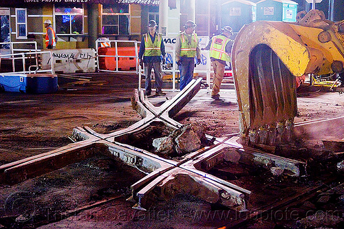 diamond crossing - railroad construction, at work, bucket attachment, demolition, diamond crossing, excavator bucket, light rail, men, muni, night, ntk, railroad construction, railroad tracks, railway tracks, san francisco municipal railway, track maintenance, track work, workers, working