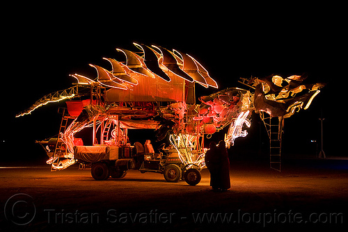 dinosaur art car, art car, burning man, dinosaur, gon kirin, night