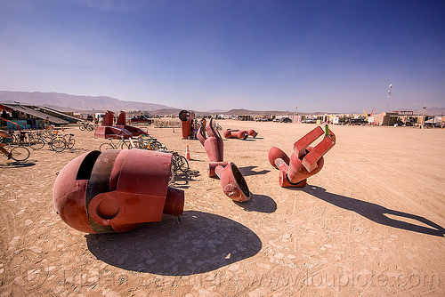 disassembling the big red robot - becoming human - burning man 2015, art installation, becoming human, burning man, christian ristow, disassembled, dismembered, head, parts, red, robot, sculpture, statue, steel