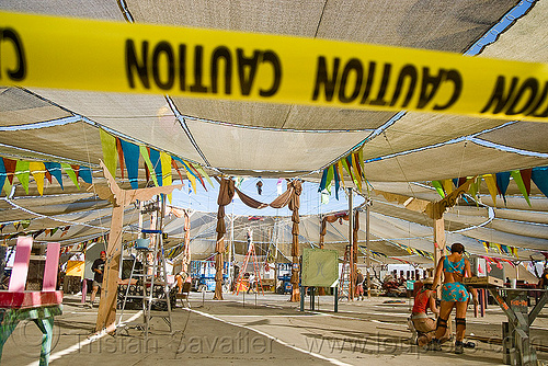 disassembling center camp cafe - burning man 2009, burning man, caution tape, safety tape, warning tape, yellow tape