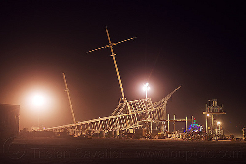 dismantling the shipwreck - burning man 2012, art, art installation, frame, mast, night, pier, pier 2, ship, wood frame, wooden frame