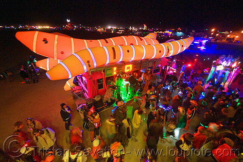 disorient art car blasting music at the bee hive - burning man 2010, akairways, art car, art installation, burning man, crowd, dancing, disorient, glowing, inflatable art, night, worms