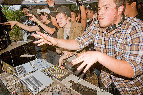 DJs at underground rave party, audio mixers, deejays, dj equipment, dj mixers, djs, hands, laptops, men, party, raver, sound, turn tables