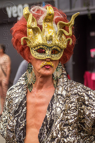 drag queen with golden carnival mask, carnival mask, drag queen, earrings, folsom street fair, man, masked, red hair, redhead, wig