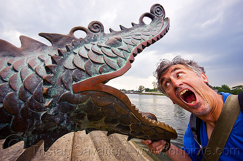 dragon's mouth, brass, dragon, head, kuching, man, metal, mouth, river, sculpture, self portrait, selfie, statue, tristan savatier