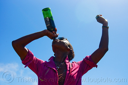 drinking a bottle of red wine, dolores park, drinking, gay pride festival, wine bottle, woman, zhú