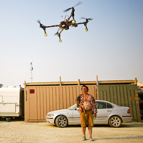 drone attacking unarmed insurgent - burning man 2013, burning man, car, drone, flying, multicopter, quadcopter, quadrocopter, quadrotor helicopter, rc, remote controlled, shipping container, uav, unmaned aerial vehicle
