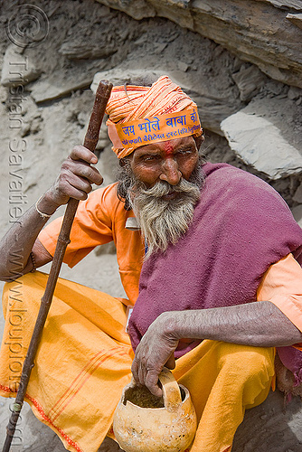 dusty sadhu (hindu holy man) resting on trail - amarnath yatra (pilgrimage) - kashmir, amarnath yatra, baba, bhagwa, hiking cane, hindu holy man, hindu pilgrimage, hinduism, india, kashmir, mountain trail, mountains, pilgrim, resting, sadhu, saffron color, trekking, walking stick