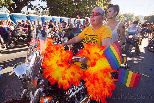 dykes on bikes - honda valkyrie, 1500cc, bald, dolores park, dykes on bikes, feather boa, gay pride festival, honda valkyrie, motorbike, motorcycle, orange feathers, rainbow flags, shaved head, women