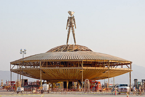 effigy stands on a large flying saucer - burning man 2013, burning man, flying saucer, the man, ufo