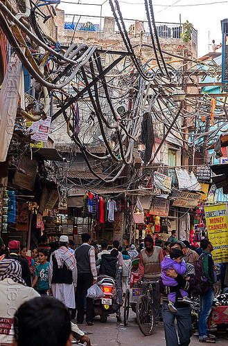 electric power lines and wiring in street (india), crowd, delhi, electric, electricity, high voltage, infrastructure, market, power lines, street, tangled, wires, wiring