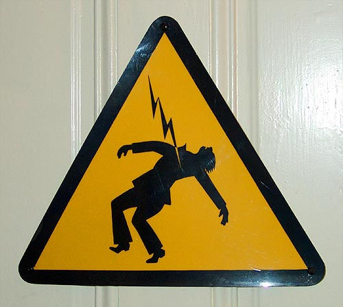 electrocuted - safety sign - high voltage - electricity hazard, danger, death, electric, electrocution, lightning, man, stick figure, stick figures in peril, triangle, triangular, yellow