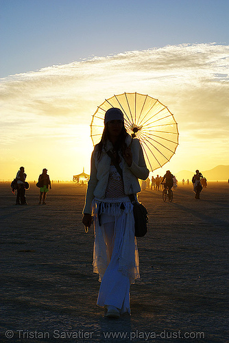elke at the silent white procession, at dawn - burning man 2007, back light, burning man, dawn, elke, parasol, silent white procession, sun rise, white morning