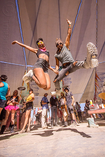 emi and nicolas jumping at center camp - burning man 2015, boot, center camp, jump, jumpshot, man, woman
