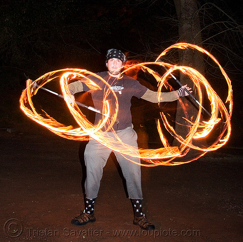 eric spinning fire staffs (san francisco), double staff, fire dancer, fire dancing, fire performer, fire spinning, fire staffs, fire staves, night, spinning fire