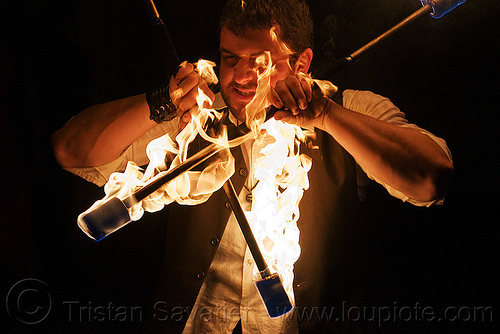 eric spinning fire staves, fire dancer, fire dancing, fire performer, fire spinning, fire staffs, fire staves, man, night