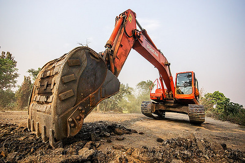 excavator scraping off old asphalt - doosan DX225LC (india), alphalt, asphalt removal, at work, bucket attachment, demolition, doosan excavator, dx225lc, excavator bucket, india, old asphalt, old bitumen, old macadam, pavement, ripping up, road construction, scraping off, west bengal, working