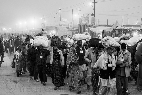 exodus - hindu pilgrims walking with luggage on their head - kumbh mela (india), bags, bundles, carrying on the head, crowd, exodus, hindu, hinduism, kumbha mela, luggage, maha kumbh mela, men, night, street, walking, women