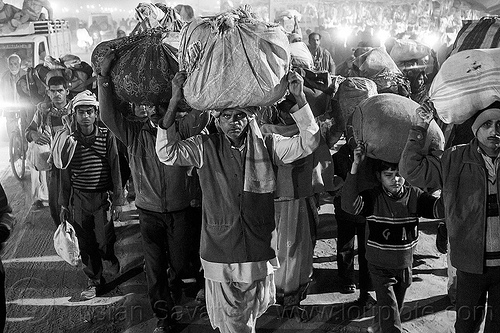 exodus - kumbh mela (india), bags, bundles, carrying, carrying on the head, crowd, hindu, hinduism, kumbha mela, luggage, maha kumbh, maha kumbh mela, men, night, people, street, walking, women