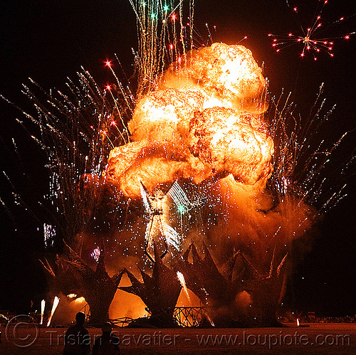 "explosion and fireworks - blowing up ""the man"" with a big explosion - burning man 2009, ball of fire, bleve, fire ball, fireworks, flame, night of the burn, pyrotechnic explosion, pyrotechnics, the burning man, the man burning"