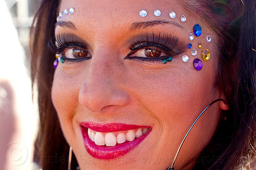 eye make-up and eye bindis, burning man decompression, earrings, eyebrow bindis, eyelashes extensions, eyeliner, long eyelashes, makeup, mascara, red lipstick, woman