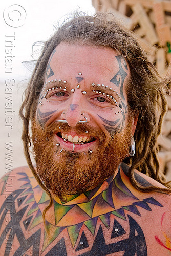 eyebrow piercing - face piercings, andrew, barbells, bridge piercing, burning man, face tattoo, gauged ears, lip piercing, people, tattooed, tattoos