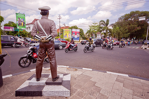 fake cop statue watching traffic - yogyakarta, cars, cop, fake, indonesia, intersection, jogja, motorcycles, police officer, police uniform, policeman, sculpture, simpatik, standing, statue, traffic, white cap, yogyakarta