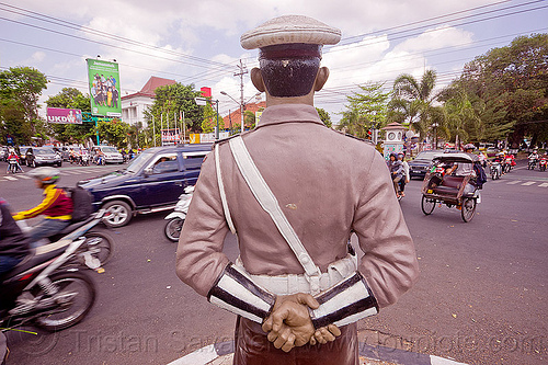fake policeman, cars, cop, fake, hands, intersection, java, jogja, jogjakarta, law enforcement, motorbikes, motorcycles, police officer, police uniform, policeman, sculpture, simpatik, standing, statue, street, traffic, white cap, yogyakarta