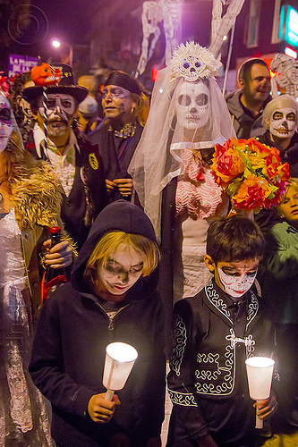 family at dia de los muertos procession, bride, candles, children, day of the dead, dia de los muertos, face painting, facepaint, family, flowers, groom, halloween, kids, night, sugar skull makeup, white veil, woman