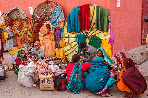 family of hindu pilgrims on the ghats of varanasi (india), hinduism, men, people, sitting, squatting, women