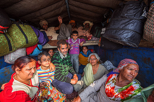 family of hindu pilgrims returning home in the back of a truck - kumbh mela (india), chil, children, exodus, family, hindu, hinduism, kids, kumbha mela, lorry, luggage, maha kumbh mela, men, truck, women