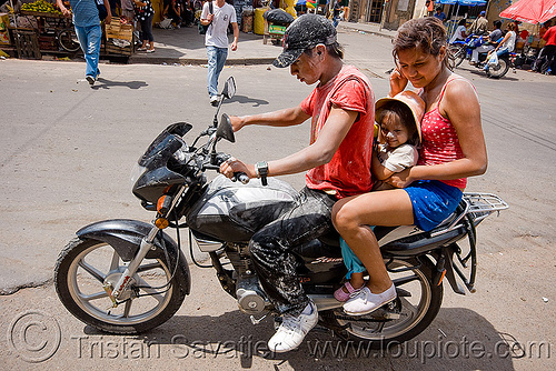 family on motorcycle - carnaval - carnival in jujuy capital (argentina), andean carnival, man, motorbike, noroeste argentino, people, rider, riding, san salvador de jujuy, three, woman