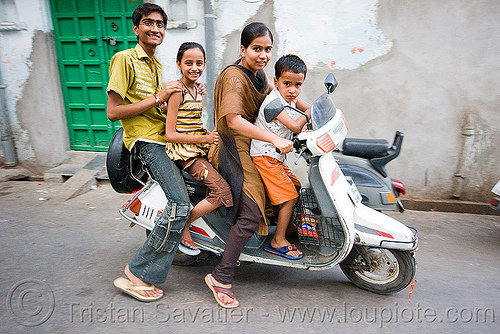 family riding motor scooter (india), boy, children, family, girl, kids, man, motorbike, motorcycle, riders, riding, scooter, street, udaipur, woman