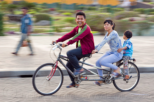 family riding tandem bike, boy, child, family, girl, jakarta, java, kid, man, medan merdeka, merdeka square, moving, park, riding, road, street, tandem bicycle, tandem bike, woman