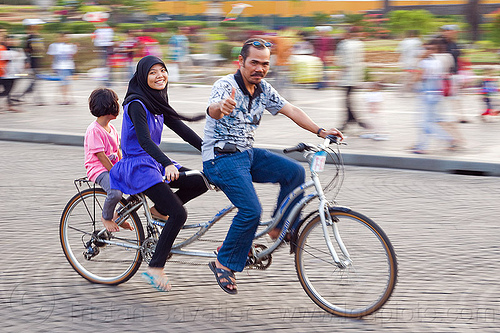 father and daughters riding tandem, child, daughters, family, father, hijab, islam, jakarta, kid, man, medan merdeka, merdeka square, moving, muslim, park, riding, road, tandem bicycle, tandem bike, thumb up, woman