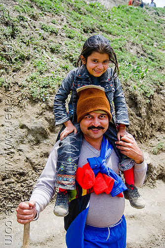 father with young daughter on his shoulder - pilgrim on trail - amarnath yatra (pilgrimage) - kashmir, amarnath yatra, children, daughter, father, hat, kashmir, kid, little girl, man, mountain trail, mountains, pilgrimage, pilgrims, trekking, yatris, अमरनाथ गुफा